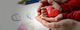Toy heart in childs hands