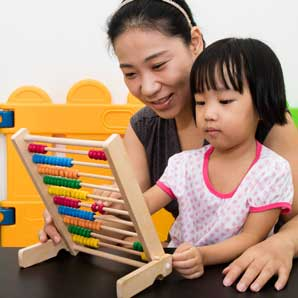 Parent playing with child on an abacus
